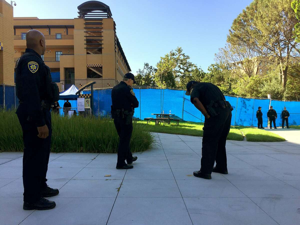 Univeristy of California Irvine campus police stand outside the gated Student Center, as members of the University of California's Board of Regents meet to discuss a controversial policy statement on intolerance in Irvine, Calif., on Thursday, Sept. 17, 2015. The University of California's first draft of system-wide principles defining intolerance is drawing protests from free-speech advocates who call it censorship and Jewish organizations that say it doesn't go far enough to protect against anti-Semitism. (AP Photo/Damian Dovarganes)