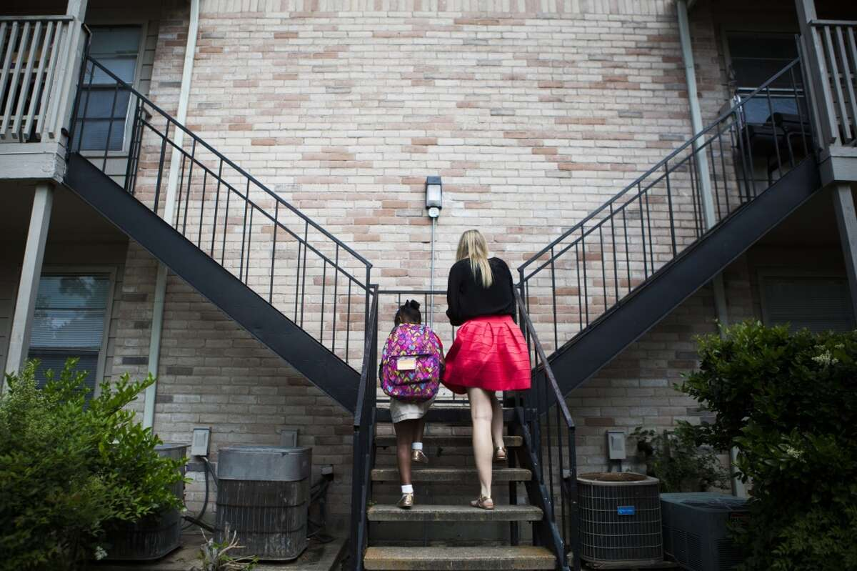 Child Protective Services caseworker Christina McKinney takes one of the children she supervises home from school. The 6-year-old girl was temporarily removed from her mother's home and sent to live with her aunt while her mother rehabilitated from drug use. Wednesday, April 15, 2015, in Houston. ( Marie D. De Jesus / Houston Chronicle )