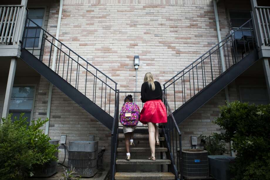 Child Protective Services caseworker Christina McKinney takes one of the children she supervises home from school. The 6-year-old girl was temporarily removed from her mother's home and sent to live with her aunt while her mother rehabilitated from drug use. Wednesday, April 15, 2015, in Houston. ( Marie D. De Jesus / Houston Chronicle ) Photo: Marie D. De Jesus, Houston Chronicle