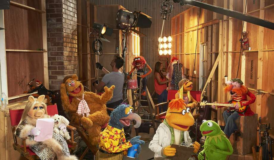 "Miss Piggy, Pepe the King Prawn, Fozzie Bear, Gonzo, Animal, Scooter, Janice, Kermit the Frog and Floyd Pepper in ""The Muppets."" Photo: Bob D'Amico, Associated Press"