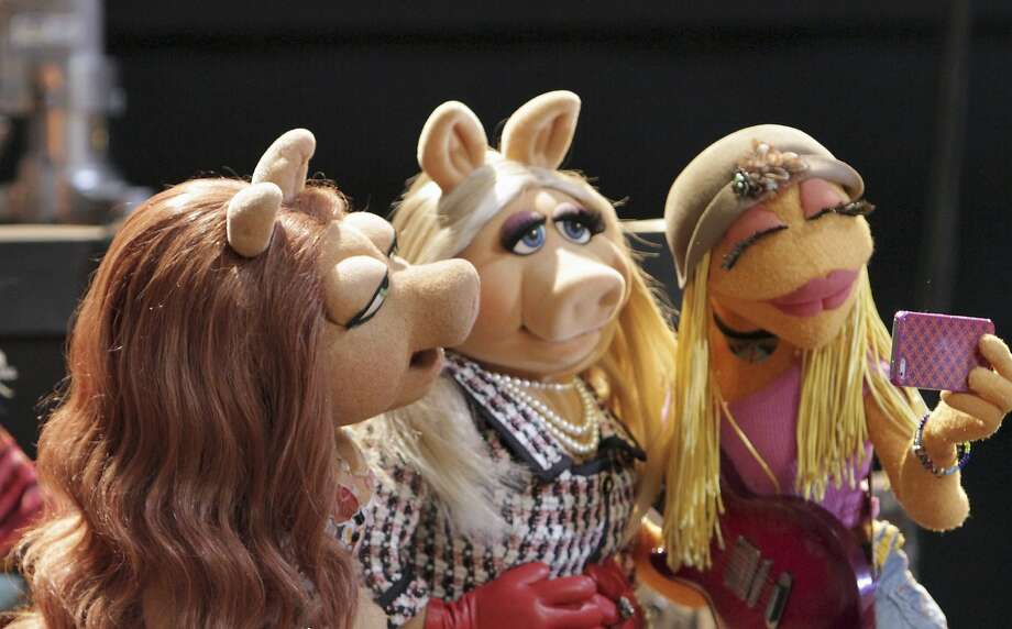 "Denise (left), Miss Piggy and Janice appear in ""The Muppets,"" which returns to ABC next week. Photo: Andrea McCallin, McClatchy-Tribune News Service"