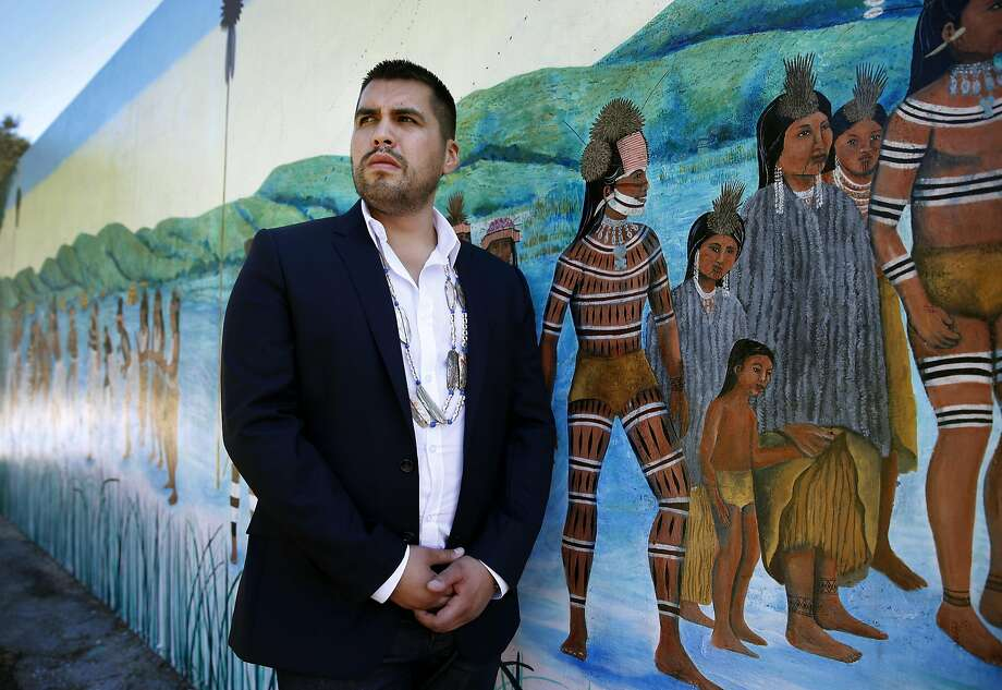 Vincent Medina visits a mural by artist Jean LaMarr which celebrates the history and culture of Ohlone Indians, at Ohlone Park in Berkeley, Calif. on Thursday, Sept. 17, 2015. Medina was chosen to read a passage in the Ohlone language of Chochenyo during the canonization ceremony of Junipero Serra by Pope Francis next week in Washington, D.C. Photo: Paul Chinn, The Chronicle