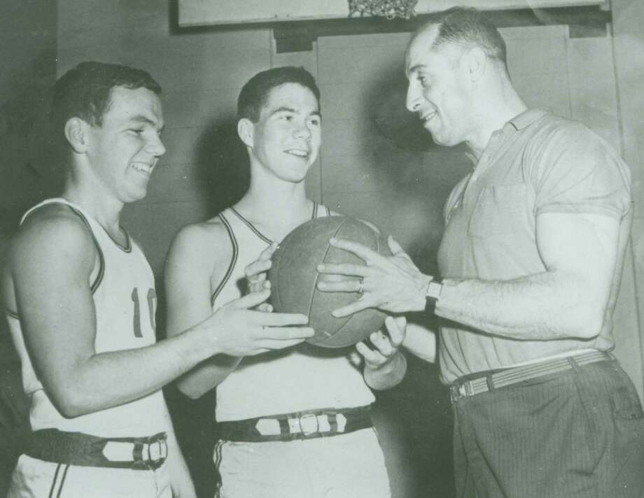 "Lou Saccone, right, was Fairfield University's freshman basketball coach in this circa 1962 file photo. During his years of playing and coaching sports in the Bridgeport area, Saccone was widely known as the ""Iron Horse."" Saccone died Sept. 9 at the age of 85. Also shown in the photo are Shaun Lavin, left, and Neil Rist. Photo: File Photo"