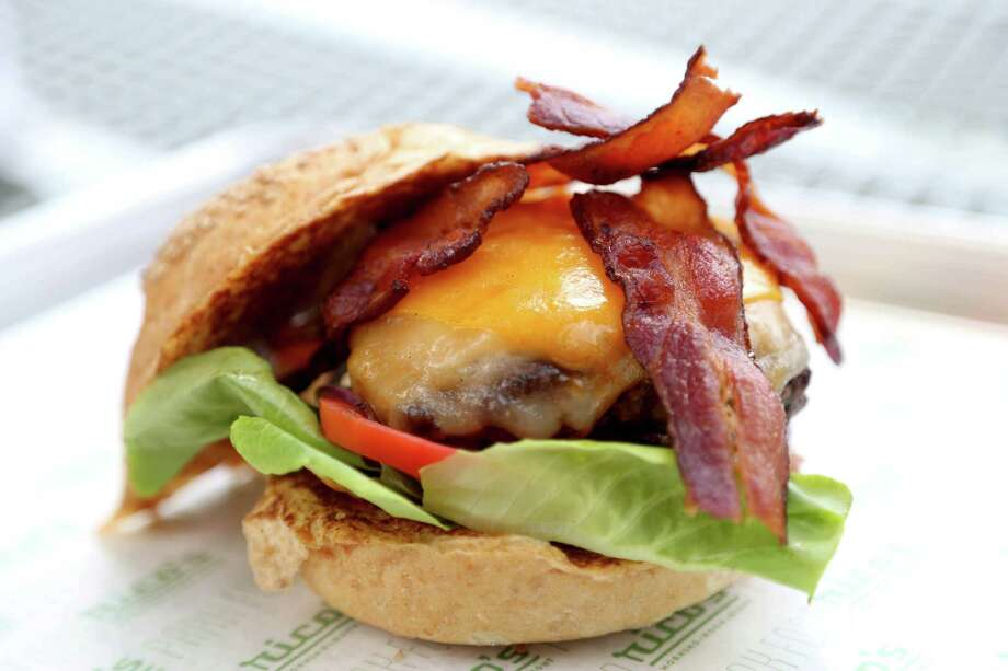 Bacon cheese burger grilled all beef burger, cheese, crispy bacon, bun, lettuce, tomatoes, onions, pickles, ketchup, mustard served at Rico's Morning + Noon Night in Bagby Park Thursday, Sept. 17, 2015, in Houston, Texas. Photo: Gary Coronado, Houston Chronicle / © 2015 Houston Chronicle