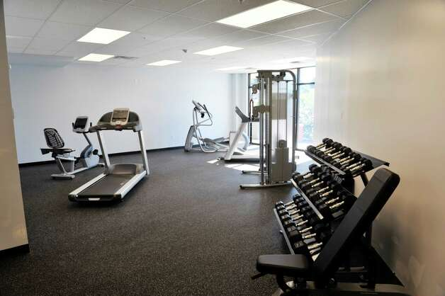 A view of the workout room at the new 2 West Ave Apartment Community, seen here on Thursday, Sept. 17, 2015, in Saratoga Springs, N.Y.  There are 63 total units, consisting of either one, two or three bedrooms.  Six of the units are town house, three bedroom, two and a half bath units.  There is also commercial space on  the ground floor and on Thursday is was announced that 2 West Bar and Grille and 2 West Express will occupy one of the commercial spaces.  The bar and grille will feature all natural burgers, hand-tossed pizzas and New York craft beers.  2 West Express will feature healthy, quick made-to-order items, like salads and wraps and artisanal pizzas.  Developers are still looking for a business to occupy the second commercial space.   (Paul Buckowski / Times Union) Photo: PAUL BUCKOWSKI / 00033345A