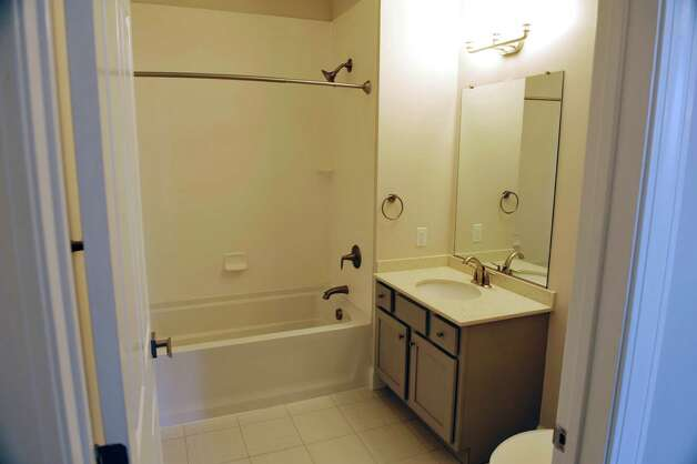 A view of the bathroom inside a one-bedroom unit at the new 2 West Ave Apartment Community, seen here on Thursday, Sept. 17, 2015, in Saratoga Springs, N.Y.  There are 63 total units, consisting of either one, two or three bedrooms.  Six of the units are town house, three bedroom, two and a half bath units.  There is also commercial space on  the ground floor and on Thursday is was announced that 2 West Bar and Grille and 2 West Express will occupy one of the commercial spaces.  The bar and grille will feature all natural burgers, hand-tossed pizzas and New York craft beers.  2 West Express will feature healthy, quick made-to-order items, like salads and wraps and artisanal pizzas.  Developers are still looking for a business to occupy the second commercial space.   (Paul Buckowski / Times Union) Photo: PAUL BUCKOWSKI / 00033345A