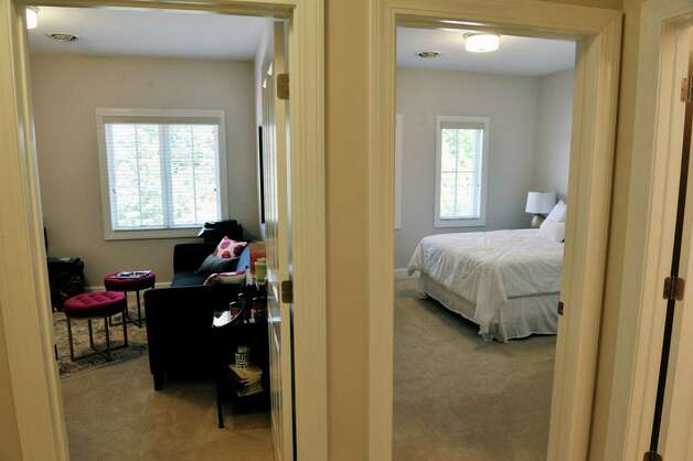 A view inside one of the town house units at the 2 West Ave Apartment Community, seen here on Thursday, Sept. 17, 2015, in Saratoga Springs, N.Y.  There are 63 total units, consisting of either one, two or three bedrooms.  Six of the units are town house, three bedroom, two and a half bath units.  There is also commercial space on  the ground floor and on Thursday is was announced that 2 West Bar and Grille and 2 West Express will occupy one of the commercial spaces.  The bar and grille will feature all natural burgers, hand-tossed pizzas and New York craft beers.  2 West Express will feature healthy, quick made-to-order items, like salads and wraps and artisanal pizzas.  Developers are still looking for a business to occupy the second commercial space.   (Paul Buckowski / Times Union) Photo: PAUL BUCKOWSKI / 00033345A