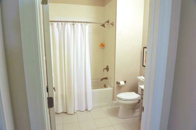 A view of the bathroom inside one of the town house units at the 2 West Ave Apartment Community, seen here on Thursday, Sept. 17, 2015, in Saratoga Springs, N.Y.  There are 63 total units, consisting of either one, two or three bedrooms.  Six of the units are town house, three bedroom, two and a half bath units.  There is also commercial space on  the ground floor and on Thursday is was announced that 2 West Bar and Grille and 2 West Express will occupy one of the commercial spaces.  The bar and grille will feature all natural burgers, hand-tossed pizzas and New York craft beers.  2 West Express will feature healthy, quick made-to-order items, like salads and wraps and artisanal pizzas.  Developers are still looking for a business to occupy the second commercial space.   (Paul Buckowski / Times Union) Photo: PAUL BUCKOWSKI / 00033345A
