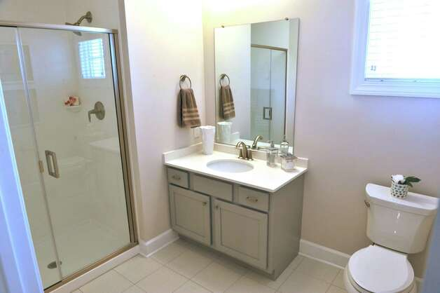 A view of the master bath inside one of the town house units at the 2 West Ave Apartment Community, seen here on Thursday, Sept. 17, 2015, in Saratoga Springs, N.Y.  There are 63 total units, consisting of either one, two or three bedrooms.  Six of the units are town house, three bedroom, two and a half bath units.  There is also commercial space on  the ground floor and on Thursday is was announced that 2 West Bar and Grille and 2 West Express will occupy one of the commercial spaces.  The bar and grille will feature all natural burgers, hand-tossed pizzas and New York craft beers.  2 West Express will feature healthy, quick made-to-order items, like salads and wraps and artisanal pizzas.  Developers are still looking for a business to occupy the second commercial space.   (Paul Buckowski / Times Union) Photo: PAUL BUCKOWSKI / 00033345A