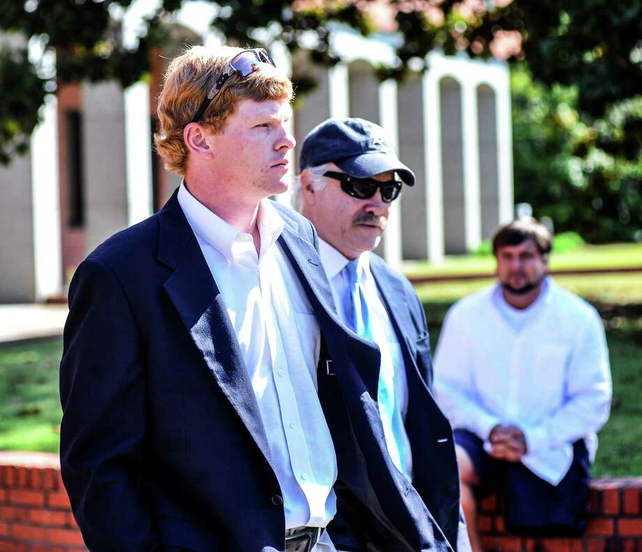 Former University of Mississippi student Graeme Phillip Harris, left, with his attorney David Hill, leaves federal court after being sentenced, Thursday, Sept. 17, 2015 in Oxford, Miss. Harris, a former University of Mississippi student who admitted helping place a noose on a statue of a civil rights activist is going to prison. U.S. District Judge Michael P. Mills sentenced Graeme Phillip Harris on Thursday to six months in prison beginning Jan. 4, followed by 12 months' supervised release. (Bruce Newman/The Oxford Eagle via AP)  NO SALES; MANDATORY CREDIT Photo: Bruce Newman, MBO / Oxford Eagle