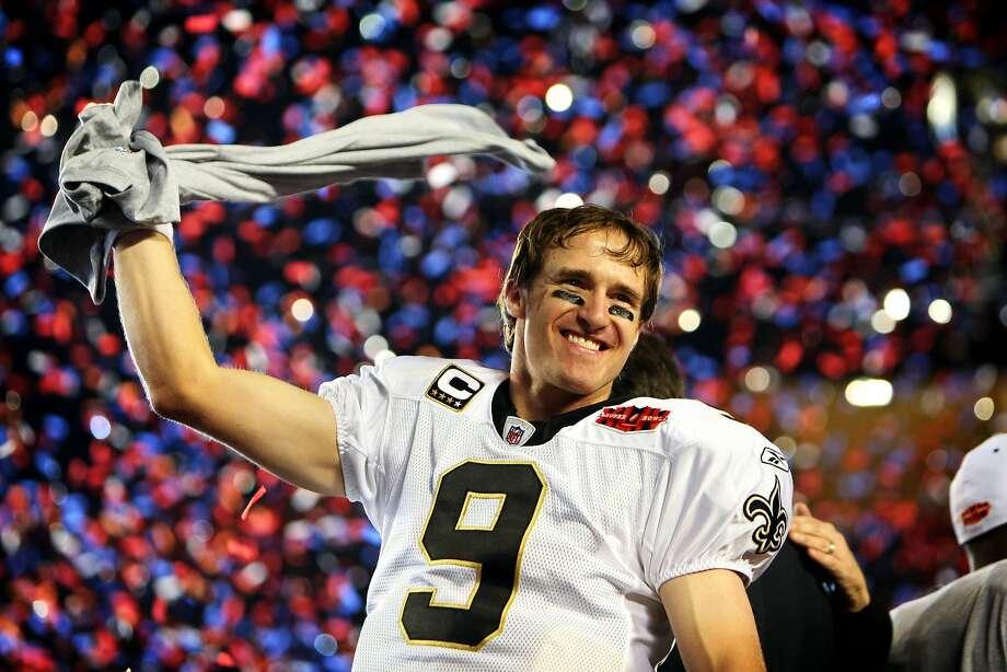 New Orleans quarterback Drew Brees celebrates after the Saints beat Indianapolis in Super Bowl XLIV. Photo: Allen Eyestone, The Palm Beach Post