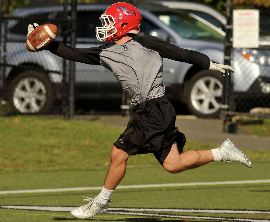 Running back Matthew Cognetta makes a catch in the endzone during football practice at New Canaan High School in New Canaan, Conn., on Thursday, Sept. 17, 2015. The Rams' first game is Friday at 7 p.m. against the Tigers in Ridgefield. Photo: Jason Rearick / Hearst Connecticut Media / Stamford Advocate