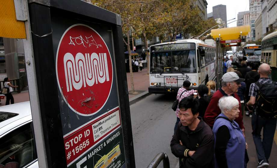 Riders board a MUNI bus along Market Street in San Francisco, Calif. as seen on Thurs. September 17, 2015.  A new survey of city residents by the San Francisco Controller's office asked them to grade local government and a host of departments. The library system scores the best and MUNI scored the worst. Photo: Michael Macor, The Chronicle