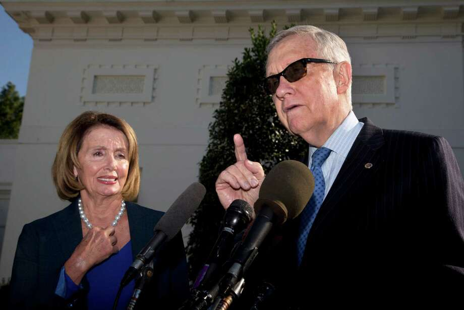 Senate Minority Leader Harry Reid of Nev., accompanied by House Minority Leader Nancy Pelosi of Calif., speaks to reporters outside the West Wing of the White House in Washington, Thursday, Sept. 17, 2015, after a meeting with President Barack Obama.    (AP Photo/Manuel Balce Ceneta) Photo: Manuel Balce Ceneta, STF / AP