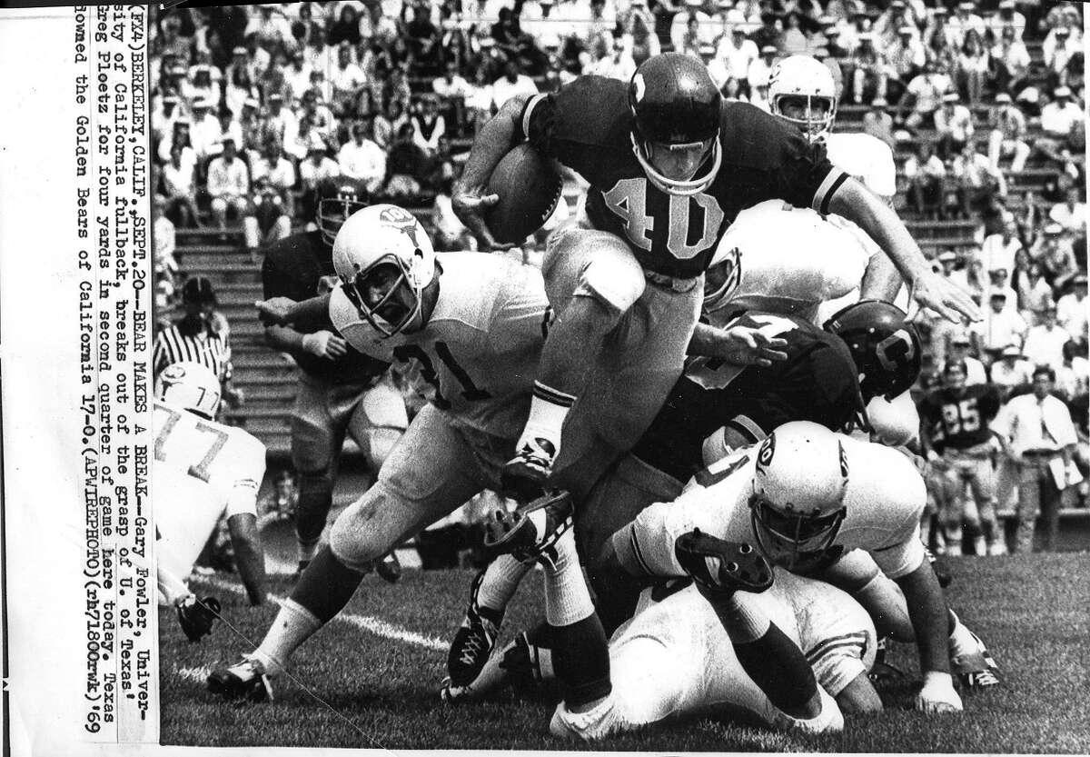 Cal loses to Texas at Memorial Stadium in Berkeley Gary Fowler Cal's fullback is pursued by Texas player Greg Ploetz 09/20/1969 Photo ran 09/22/1969 AP photo