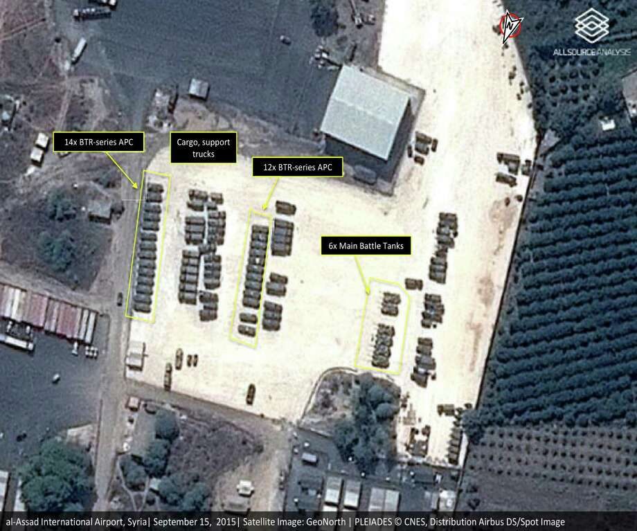 """This Tuesday, Sept. 15, 2015 satellite image with annotations provided by GeoNorth, AllSource Analysis, Airbus shows Russian tanks and armed personnel carriers at an air base in Latakia province, Syria. Russia on Thursday strongly urged the United States and its allies to engage the Syrian government as a """"partner"""" in the fight against the Islamic State group, and offered to share any information about its military supplies to Damascus with Washington. (GeoNorth, AllSource Analysis, Airbus via AP) Photo: HONS / GeoNorth, AllSource Analysis, Ai"""