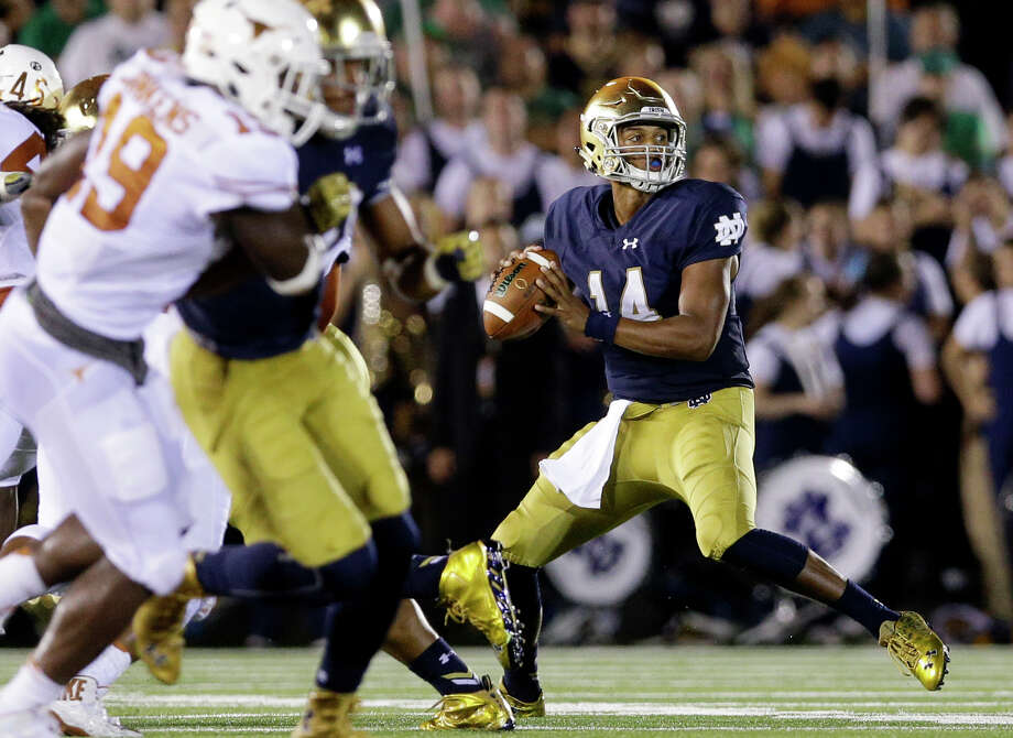 In this photo taken Saturday, Sept. 5, 2015, Notre Dame quarterback DeShone  Kizer (14) looks to a pass during the second half of an NCAA college football game against Texas in South Bend, Ind. Kizer didn't impress Notre Dame at first. The 6-foot-4, 230-pound sophomore quarterback, who bailed the Fighting Irish out with a game-winning 39-yard touchdown last week against Virginia, crossed Notre Dame off his recruiting list after throwing for then-offensive coordinator Chuck Martin. (AP Photo/Nam Y. Huh) ORG XMIT: INNH101 Photo: Nam Y. Huh / AP