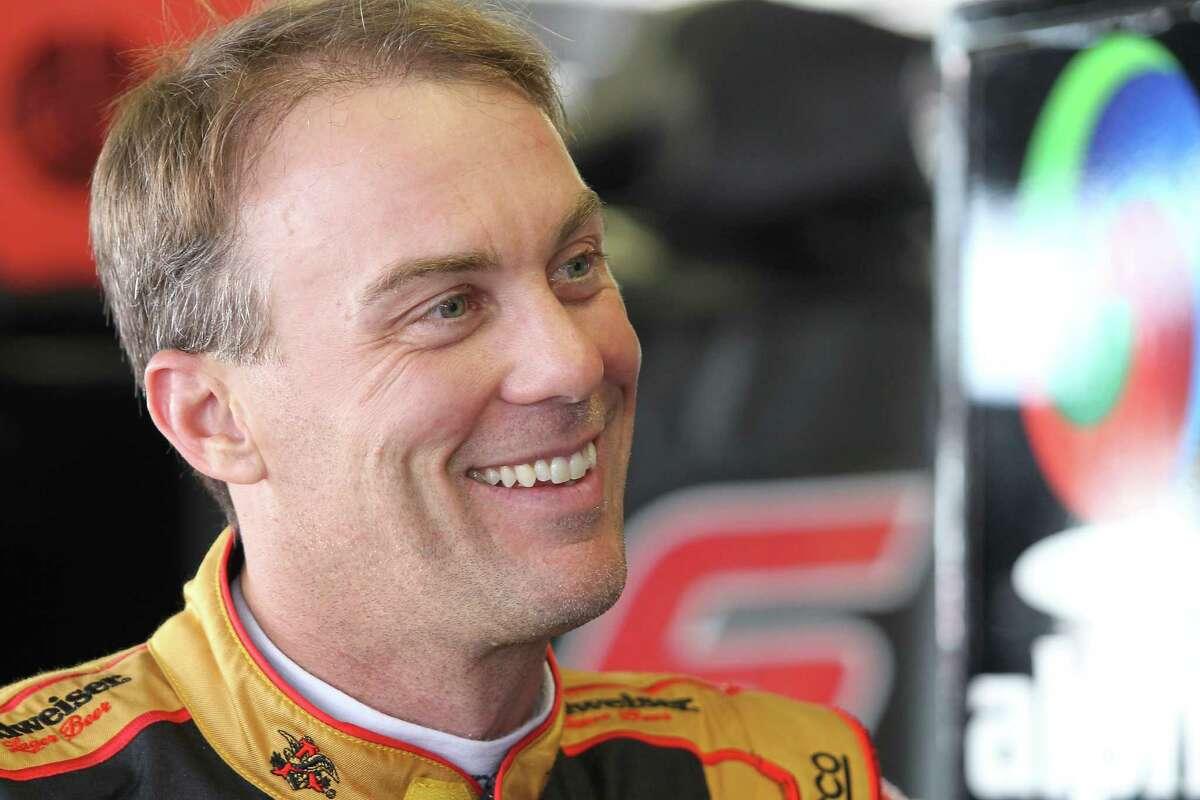 DARLINGTON, SC - SEPTEMBER 04: Kevin Harvick, driver of the #88 Armour Sandwich Creations Chevrolet, stands in the garage area during practice for the NASCAR XFINITY Series VFW Sport Clips Help A Hero 200 at Darlington Raceway on September 4, 2015 in Darlington, South Carolina. (Photo by Kena Krutsinger/Getty Images) ORG XMIT: 532292005
