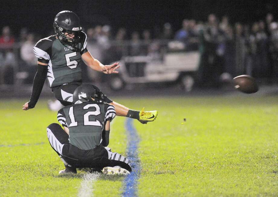 Schalmont's Anthony Yezzo (12) holds as Jake Defayette (5) kicks an extra point against Burnt Hills-Ballston Lake during the first half of their Section II football game on Friday, Sept. 26, 2014, in Rotterdam, N.Y., (Hans Pennink / Special to the Times Union) ORG XMIT: HP115 Photo: Hans Pennink / Hans Pennink