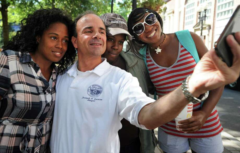 Mayoral candidate Joe Ganim takes a selfie with supporters, from left, Tamika Gordon, LaToya Fuller and Rain Anthony, Thursday on McLevy Green in Bridgeport as he walks downtown thanking voters following his primary election win. Photo: Autumn Driscoll / Hearst Connecticut Media / Connecticut Post