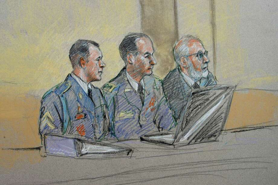 Army Sgt. Bowe Bergdahl, left, defense counsel Lt. Col. Franklin Rosenblatt, center, and lead counsel Eugene Fidell sit during a preliminary hearing in Bergdahl's case. Photo: Brigitte Woosley, FRE / FR170958 AP
