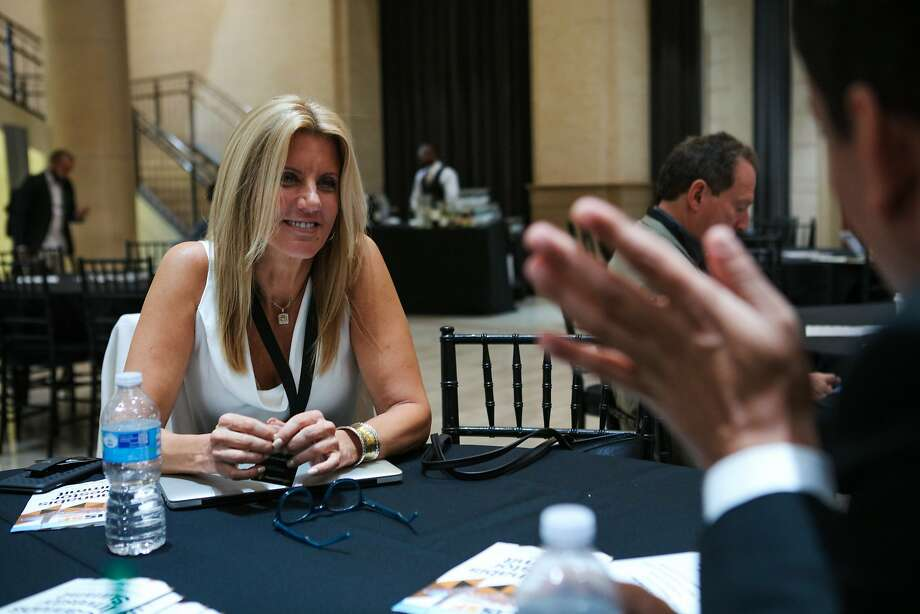 Natalie DeMarco, a consultant from Florida chats with a colleague at the Cannabis Investor Summit at the Bentley Reserve in downtown San Francisco, California on Thursday, September 17, 2015. Photo: Gabrielle Lurie, Special To The Chronicle
