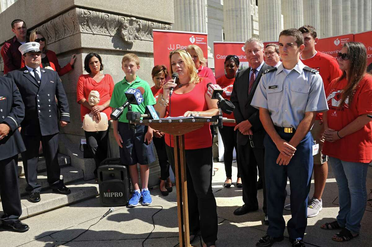 Annette Adamczak of Akron, who's 14 yr-old daughter Emily died six years ago, speaks on the steps of the State Education Building as advocates celebrate final step in years-long CPR in schools efforts on Thursday, Sept. 17, 2015 in Albany, N.Y. (Lori Van Buren / Times Union)