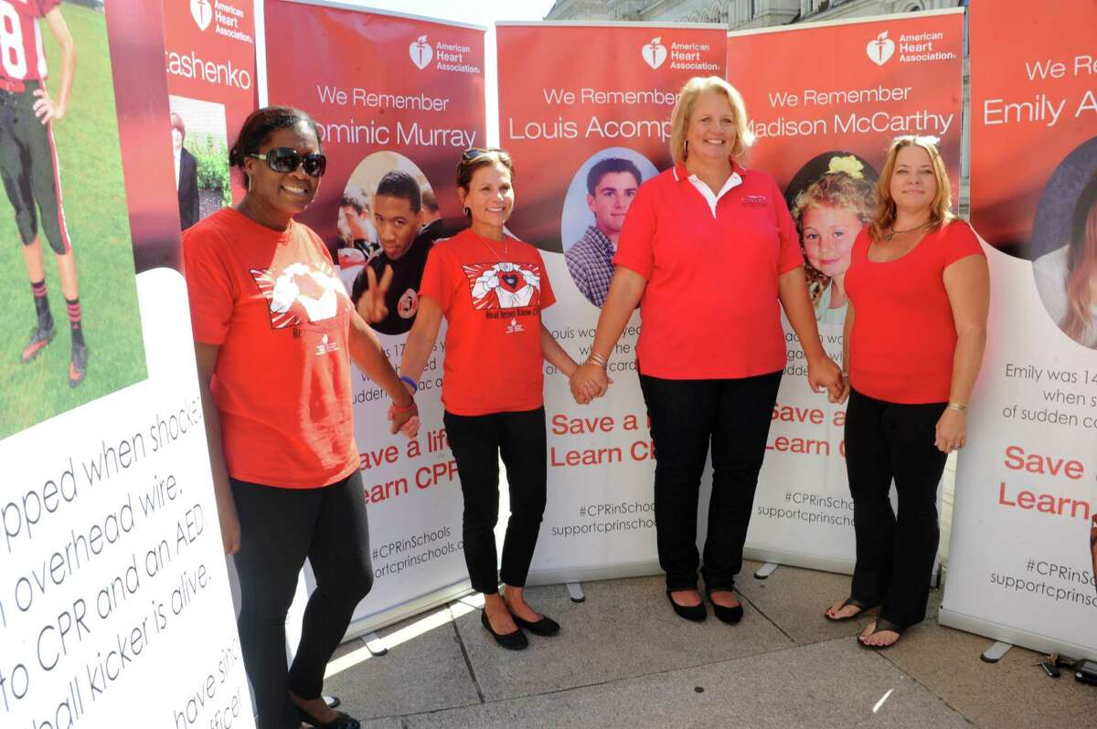 From left, Melinda Murray of Queens, Karen Acompora of Northport, Jen Pesany of Lancaster and Annette Adamczak of Akron stand on the steps of the State Education Building as advocates celebrate final step in years-long CPR in schools efforts on Thursday, Sept. 17, 2015 in Albany, N.Y. All these mothers lost their children except for Pesany whose son was saved by CPR. (Lori Van Buren / Times Union)