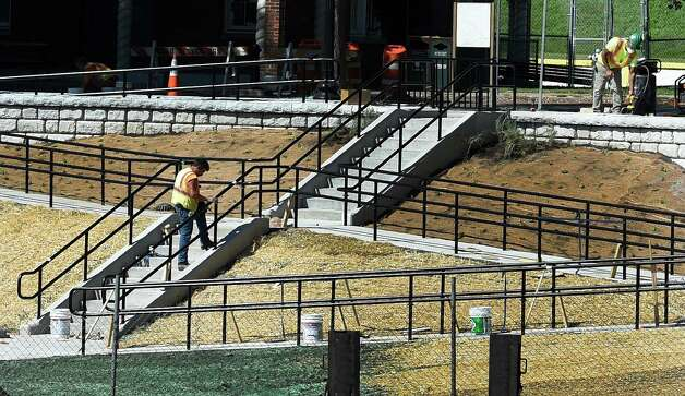 Finishing touches are being put on the stairs at Lincoln Park near the pool, Thursday afternoon Sept. 17, 2015,  which will be dedicated Saturday by Mayor Sheehan at 4th annual Mississippi Day in Albany, N.Y.     (Skip Dickstein/Times Union) Photo: SKIP DICKSTEIN / 00033410A