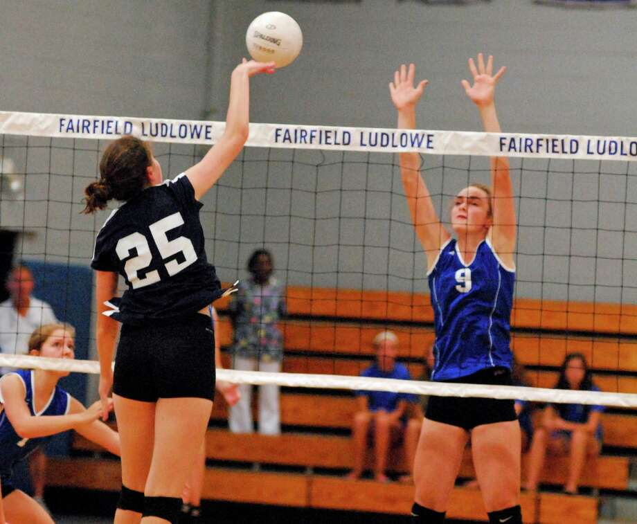 Staples' Annemieke Mathissen, left, tries to hit the ball past Zoe Holderied during a girls volleyball game in Fairfield, Connecticut on Thursday, Sept. 17th 2015. Ludlowe won the match 3-1. Photo: Ryan Lacey/Staff Photo / Westport News Contributed