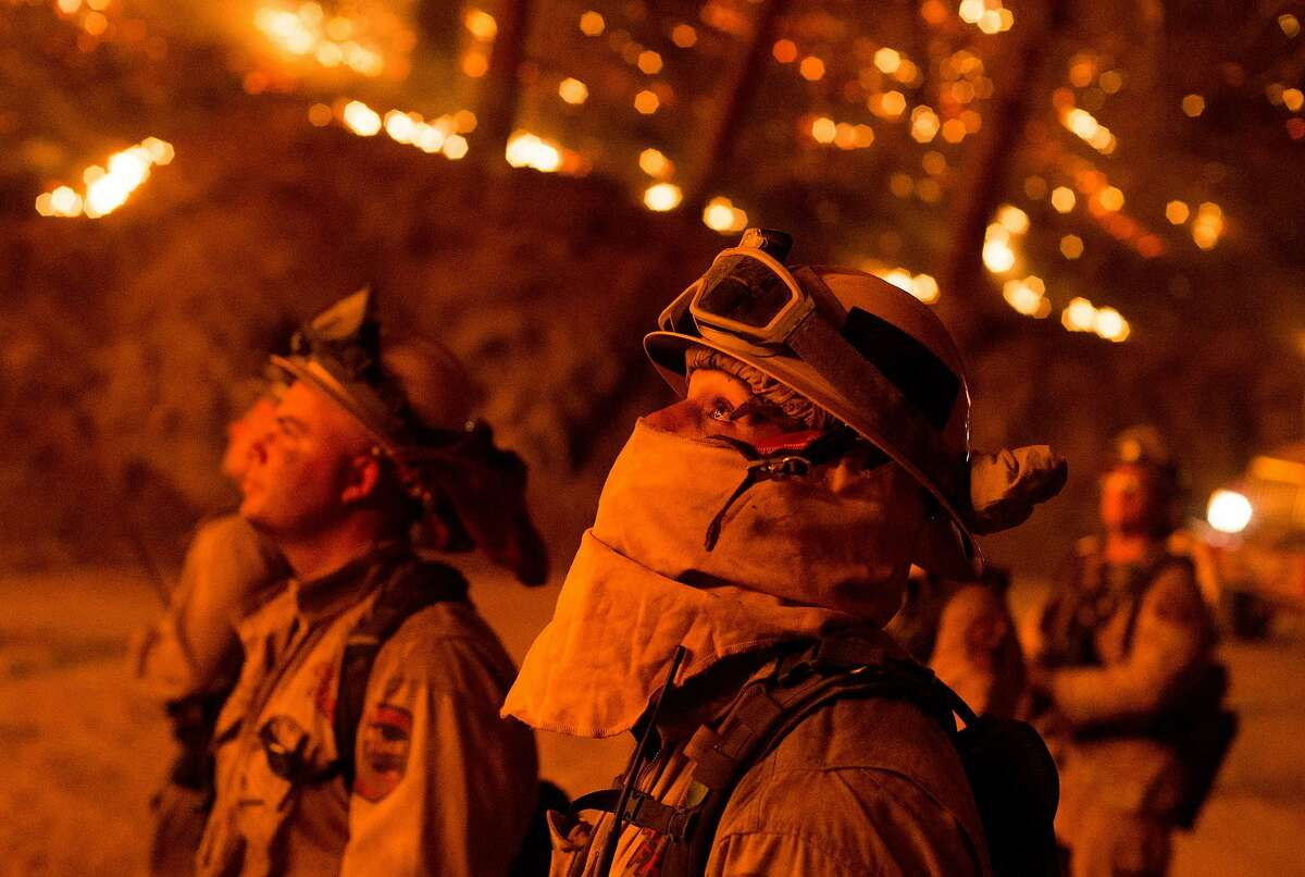 TOPSHOTS Firefighters monitor a backfire while battling the Butte fire near San Andreas, California on September 12, 2015. According to state fire agency CAL FIRE, the fire has burned more than 65,000 acres and 86 homes. AFP PHOTO / JOSH EDELSONJosh Edelson/AFP/Getty Images