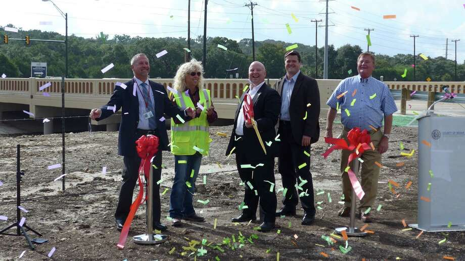 Bexar County Precinct 3 Commissioner Kevin Wolff leads a group of officials, contractors and others on Thursday, Sept. 17, 2015, at a ceremony marking completion of $ 8 million in flood-control installations at Bulverde Road and Wilderness Oak. Photo: John W. Gonzalez / San Antonio Express-News