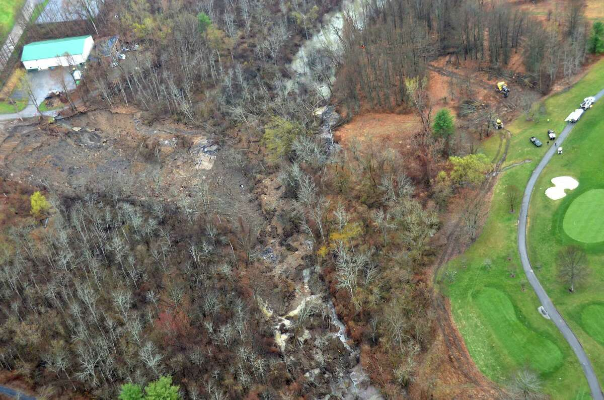 View from a state police helicopter of the mudslide into the Normans Kill on Monday, April 20, 2015 in Delmar, N.Y. The Normanside Country Club is seen at left. Capital Hills at Albany golf course is seen at right. (Courtesy of New York State Police)
