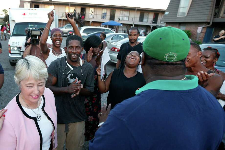 Residents of the Crestmont Apartment Complex, in the 5600 Block of Selinsky, cheer for Mayor Annise Parker, who announced that the city was intervening after the landlord has refused to pay the electricity bill. Photo: Karen Warren, Staff / © 2015 Houston Chronicle