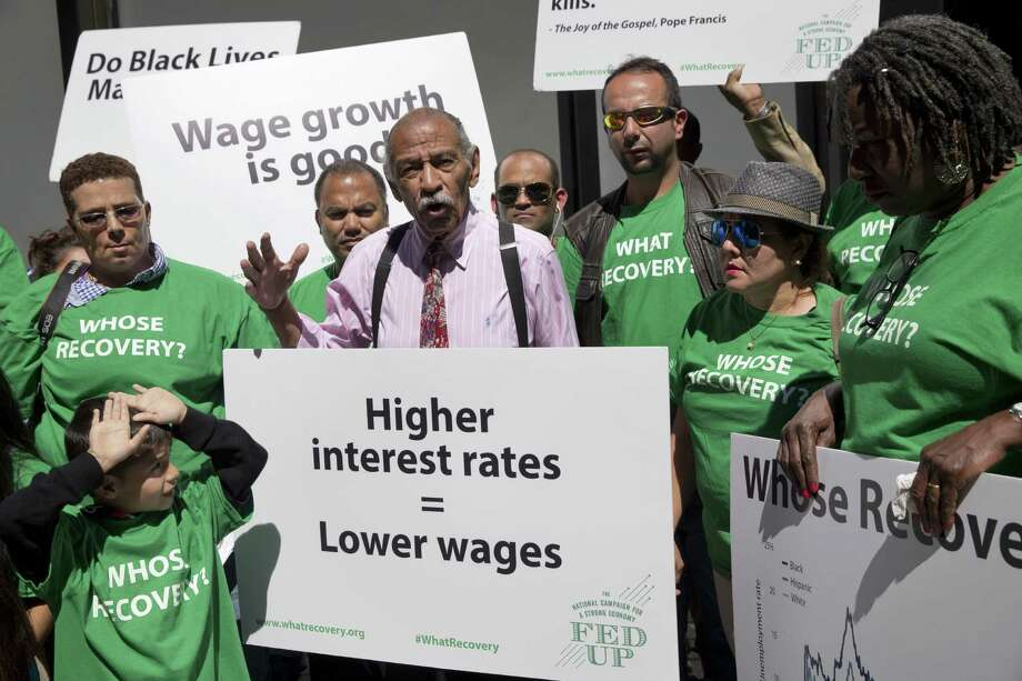 Rep. John Conyers, D-Mich., center, accompanied by demonstrators, speaks Thursday outside the Federal Reserve. He introduced legislation directing the Fed to push the U.S. unemployment rate below 4 percent.  Photo: Jacquelyn Martin, STF / AP