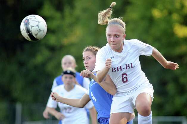 Burnt Hills' Casey Doherty, right, beats Saratoga's Chloe Ray to the header during their soccer game on Thursday, Sept. 17, 2015, at Burnt Hills High in Burnt Hills, N.Y. (Cindy Schultz / Times Union) Photo: Cindy Schultz / 00033375A