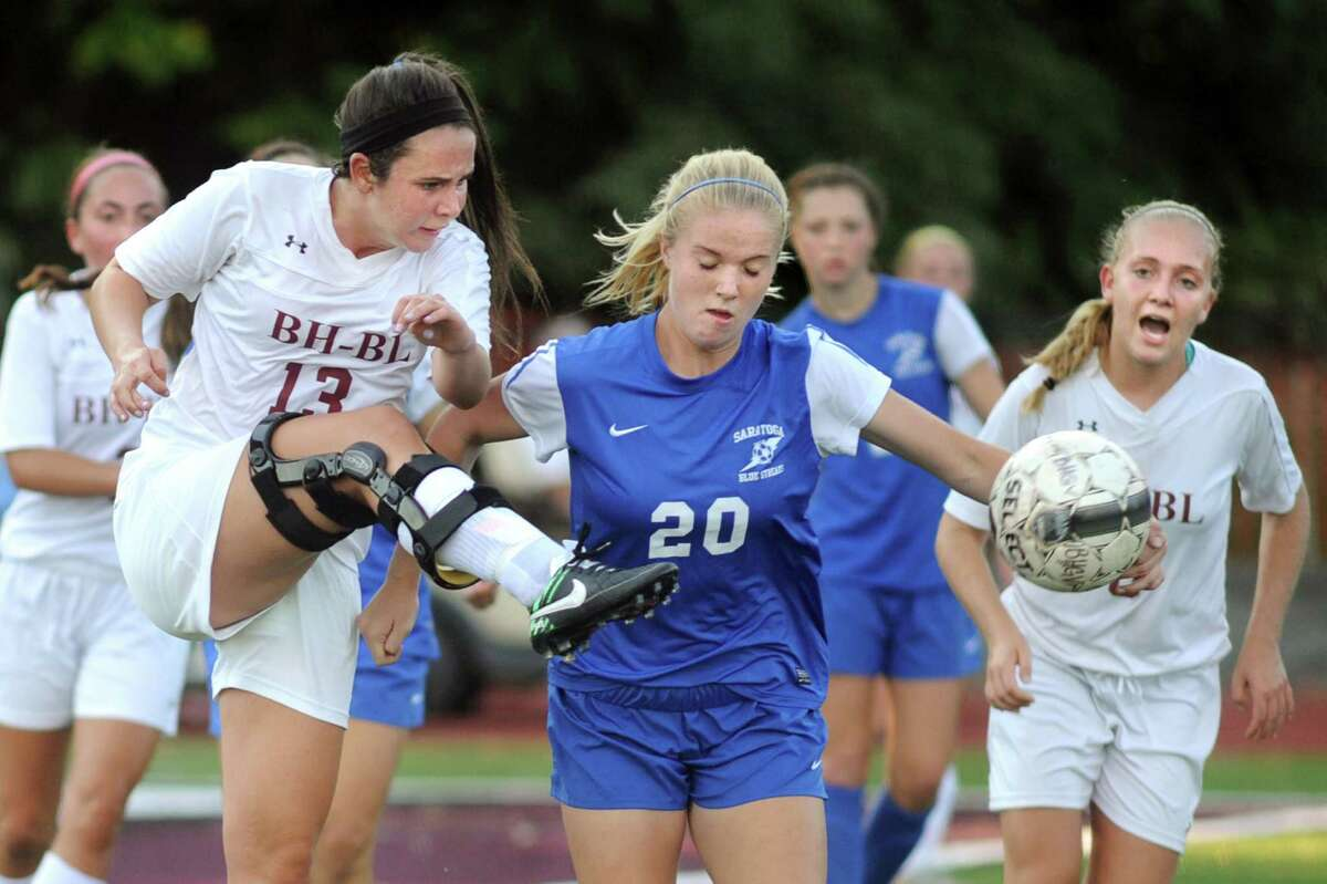 Burnt Hills' Kylee Babcock, left, clears the corner kick away from Saratoga's Emma Eldred, center, during their soccer game on Thursday, Sept. 17, 2015, at Burnt Hills High in Burnt Hills, N.Y. (Cindy Schultz / Times Union)
