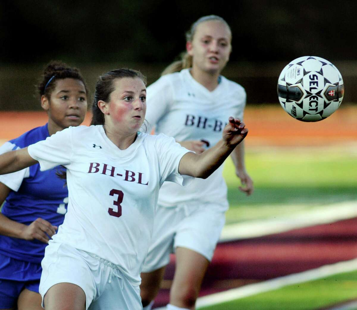 Burnt Hills' Amalia Daviero, center, and Casey Doherty, right, and Saratoga's Ya'nique Van Ness chase after a loose ball during their soccer game on Thursday, Sept. 17, 2015, at Burnt Hills High in Burnt Hills, N.Y. (Cindy Schultz / Times Union)