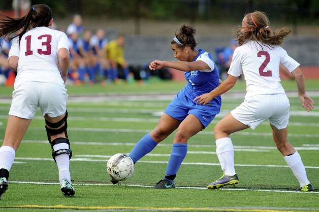 Saratoga's Ya'nique Van Ness, center, controls the ball as Burnt Hills' Kylee Babcock, left, and Alyssa Hughes defend during their soccer game on Thursday, Sept. 17, 2015, at Burnt Hills High in Burnt Hills, N.Y. (Cindy Schultz / Times Union) Photo: Cindy Schultz / 00033375A