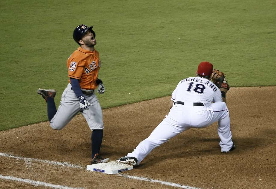 Sept. 17: Rangers 8, Astros 2   Houston Astros' Jose Altuve, left, reacts after hitting into a double play, as Texas Rangers' Mitch Moreland catches the throw during the seventh inning of a baseball game Thursday, Sept. 17, 2015, in Arlington, Texas. Jonathan Villar was out at third on the play. (AP Photo/Tony Gutierrez) Photo: Tony Gutierrez, Associated Press