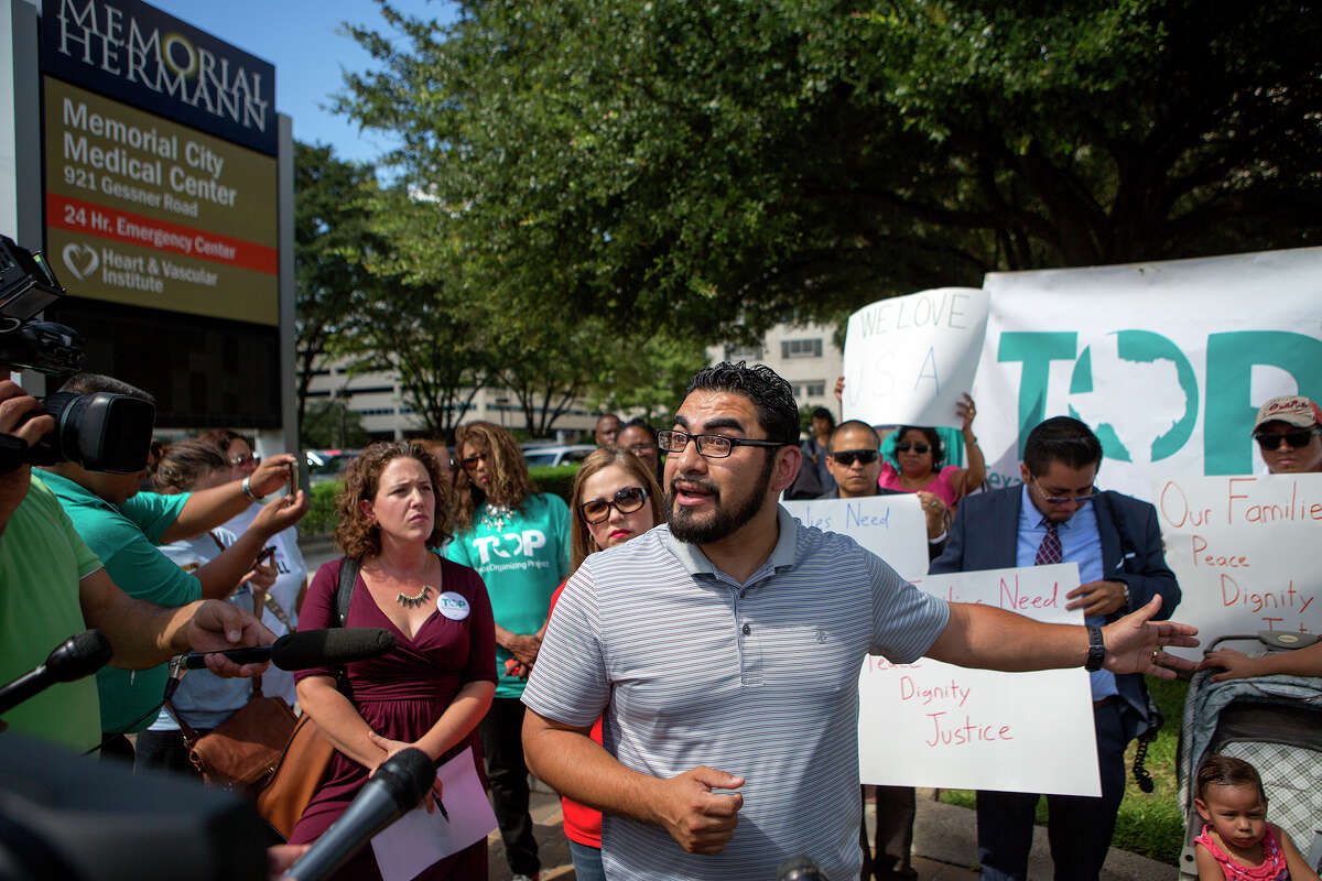 State Representative Armando Walle, stands with members of the Texas Organizing Project, as he speaks during a protest at Memorial Hermann Health System's headquarters, Thursday, Sept. 17, 2015, in Houston. The protest was held after the arrest of Blanca Borrego, an undocumented mother who was seeking medical treatment.