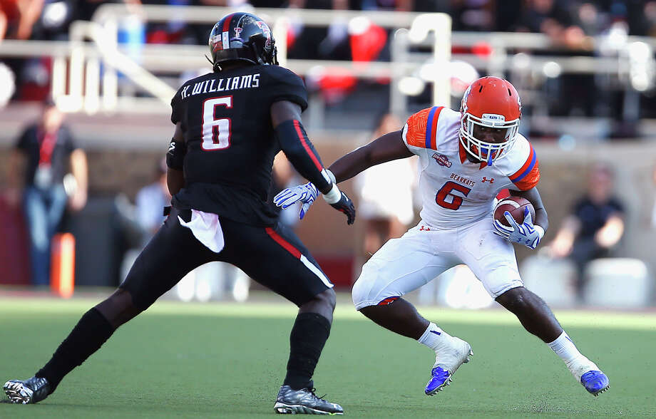Sam Houston States' Cory Avery runs the ball as Texas Tech's Kris Williams approaches during an NCAA college football game against Sam Houston State, Saturday, Sept. 5, 2015, in Lubbock, Texas. (Allison Terry/Lubbock Avalanche-Journal via AP) ALL LOCAL TELEVISION OUT; MANDATORY CREDIT Photo: Allison Terry, MBI / Lubbock Avalanche-Journal