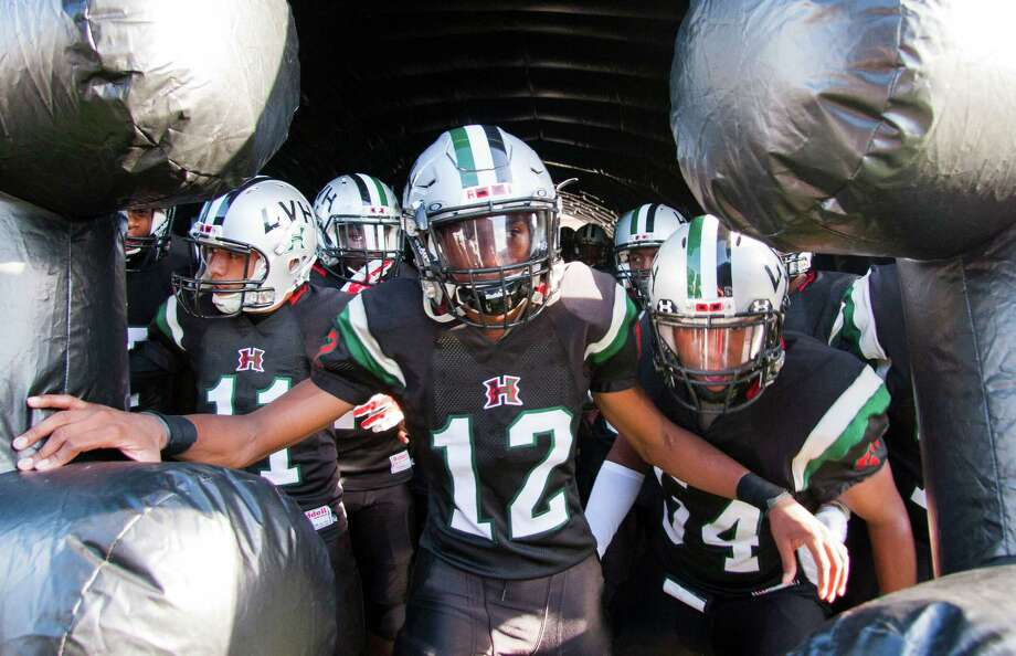 Hightower's Blair Simon (12) leads his team onto the field at Hall Stadium earlier this season. Photo: Joe Buvid, Freelance / © 2015 Joe Buvid