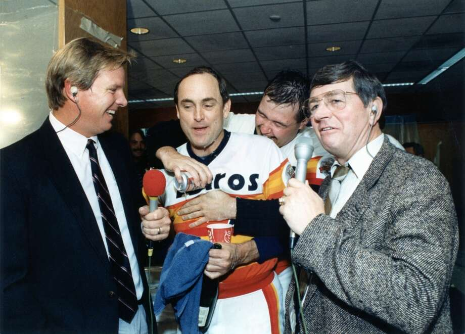 09/25/1986 - Houston Astros announcers Larry Dierker, left, and Milo Hamilton, right, try to interview Nolan Ryan amid Astros celebration of victory to clinch the NL West division title. Photo: Bruce Bennett, Houston Chronicle
