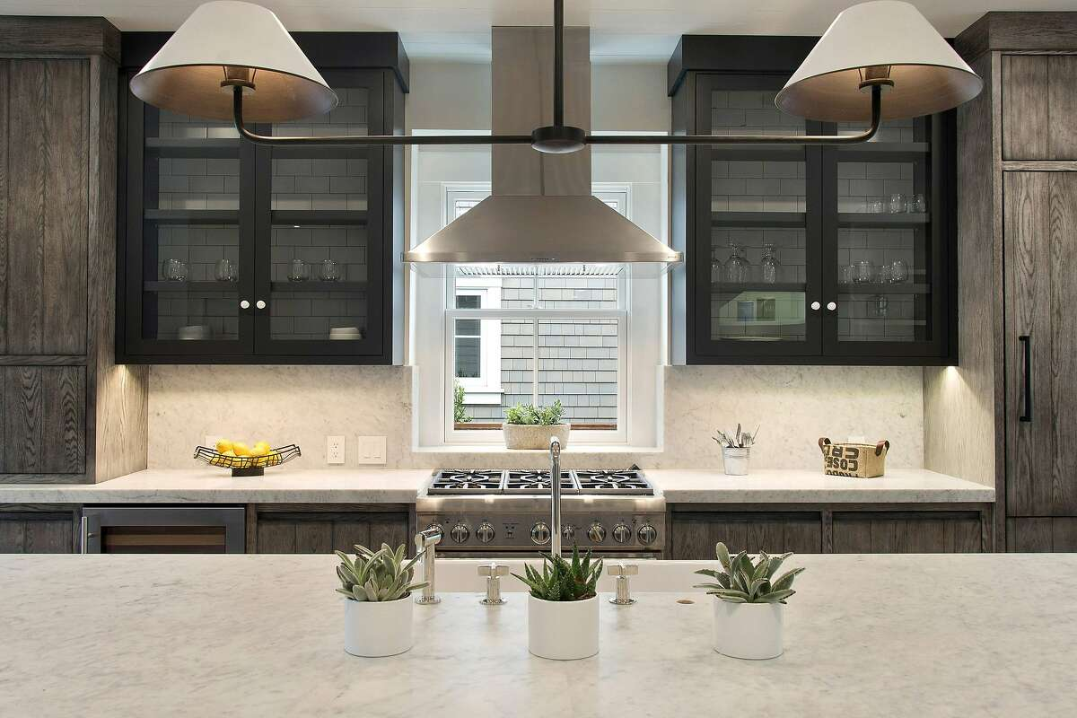 Subway tiles accent raised cabinets in the kitchen.