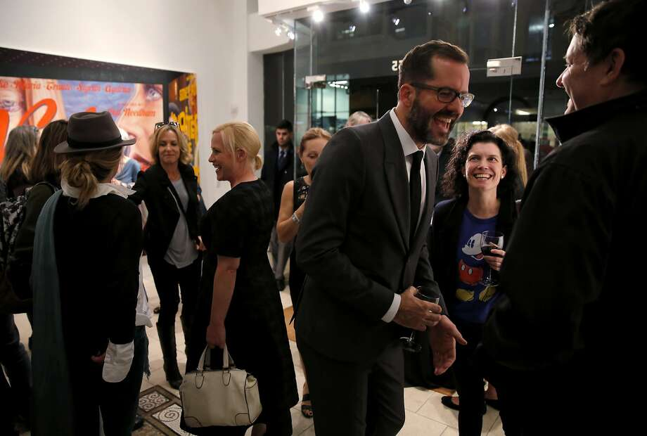 "Actress Patricia Arquette (left center) and Eric White (right center) entertain attendees of the U.S. premiere of White's ""New Works"" exhibit at Serge Sorokko Gallery in San Francisco, California, on Thursday, Sept. 17, 2015. Photo: Connor Radnovich, The Chronicle"