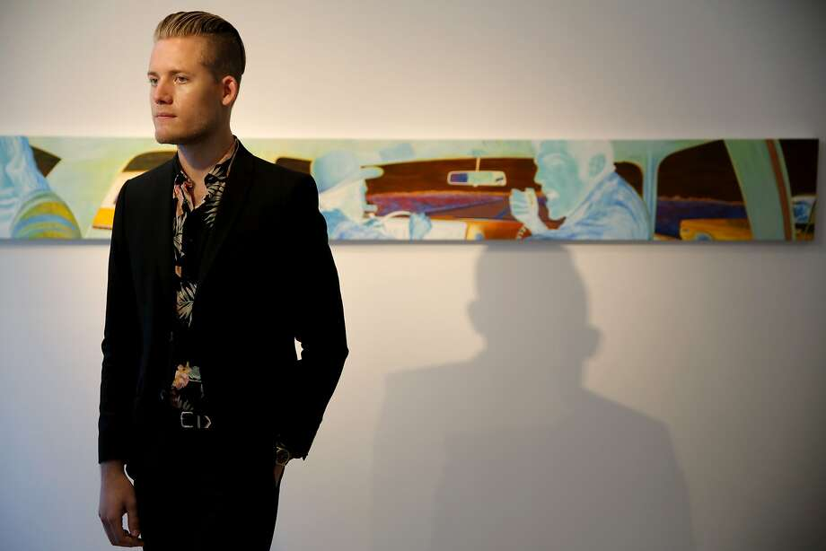 "Mark Olson stands in front of a painting during the U.S. premiere of Eric White's ""New Works"" exhibit at Serge Sorokko Gallery in San Francisco. Photo: Connor Radnovich, The Chronicle"