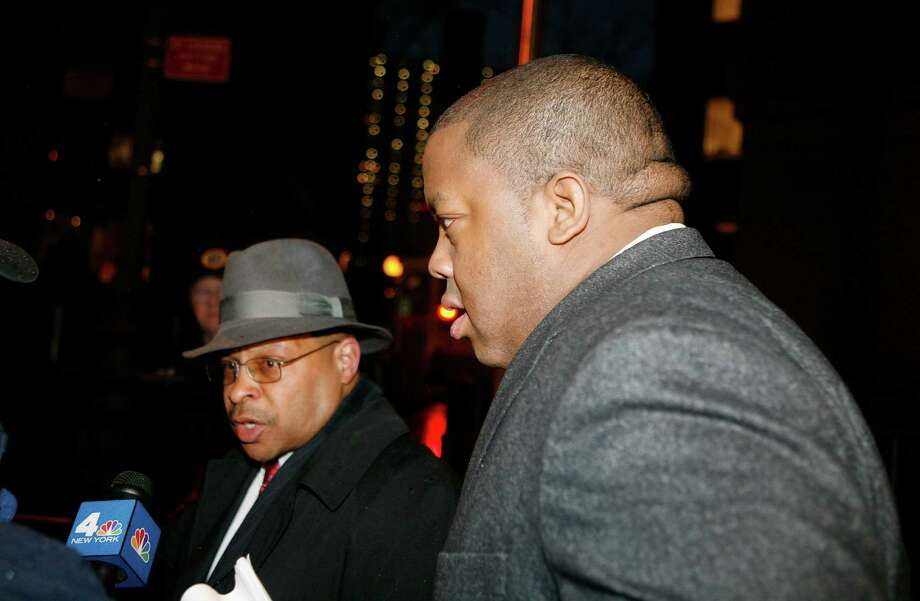 FILE- In this March 10, 2011 file photo, Brooklyn Assemblyman William Boyland, right, exits Federal Court in New York. The former state assemblyman from a family of Brooklyn politicians was sentenced Thursday, Sept. 17, 2015 to 14 years in prison in a scheme to take bribes from a carnival promoter and two undercover FBI agents posing as out-of-town real estate investors. (AP Photo/David Karp, File) ORG XMIT: NYR103 Photo: David Karp / FR50733 AP