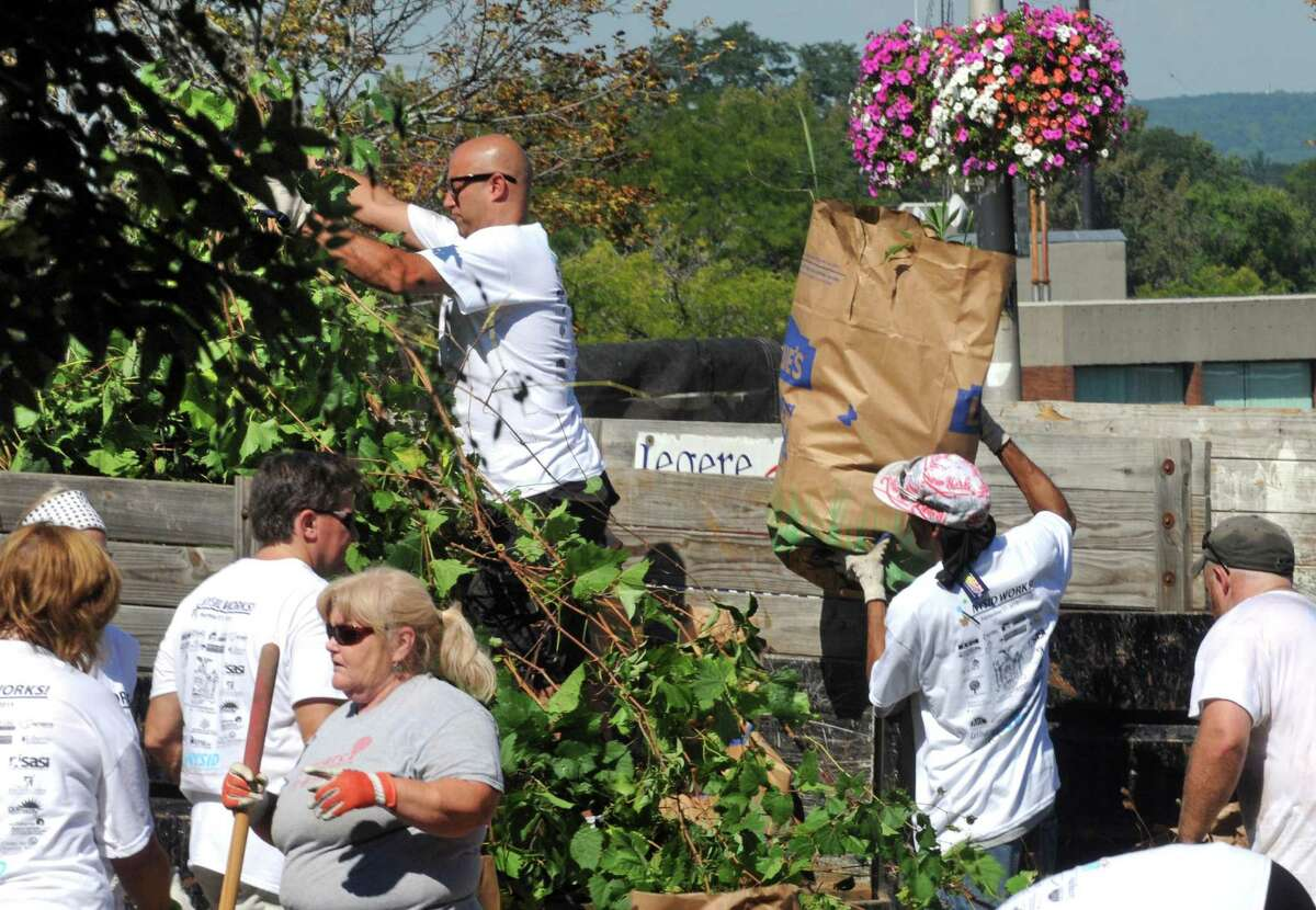 New York State Industries for the Disabled coordinated the beautification of the miSci's entry space around the locomotive, and two adjacent lots on the miSci property with the help of more then fifty volunteers from NYSID, Schenectady ARC and Assemblymember Angelo Santabarbara office on Thursday Sept. 17, 2015 in Schenectady, N.Y. (Michael P. Farrell/Times Union)