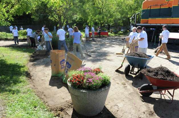New York State Industries for the Disabled coordinated the beautification of the miSci's entry space around the locomotive, and two adjacent lots on the miSci property with the help of more then fifty volunteers from NYSID, Schenectady ARC and Assemblymember Angelo Santabarbara office on Thursday Sept. 17, 2015 in Schenectady, N.Y.  (Michael P. Farrell/Times Union) Photo: Michael P. Farrell / 00033264A